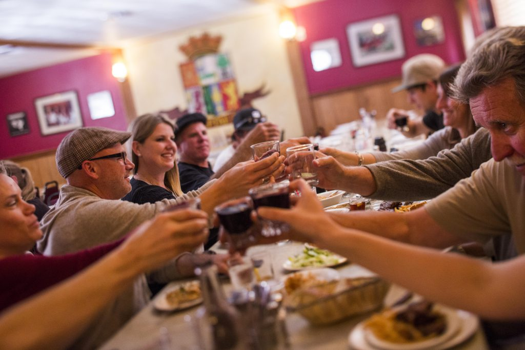 group of lake tahoe tourists toasting in a restaurant